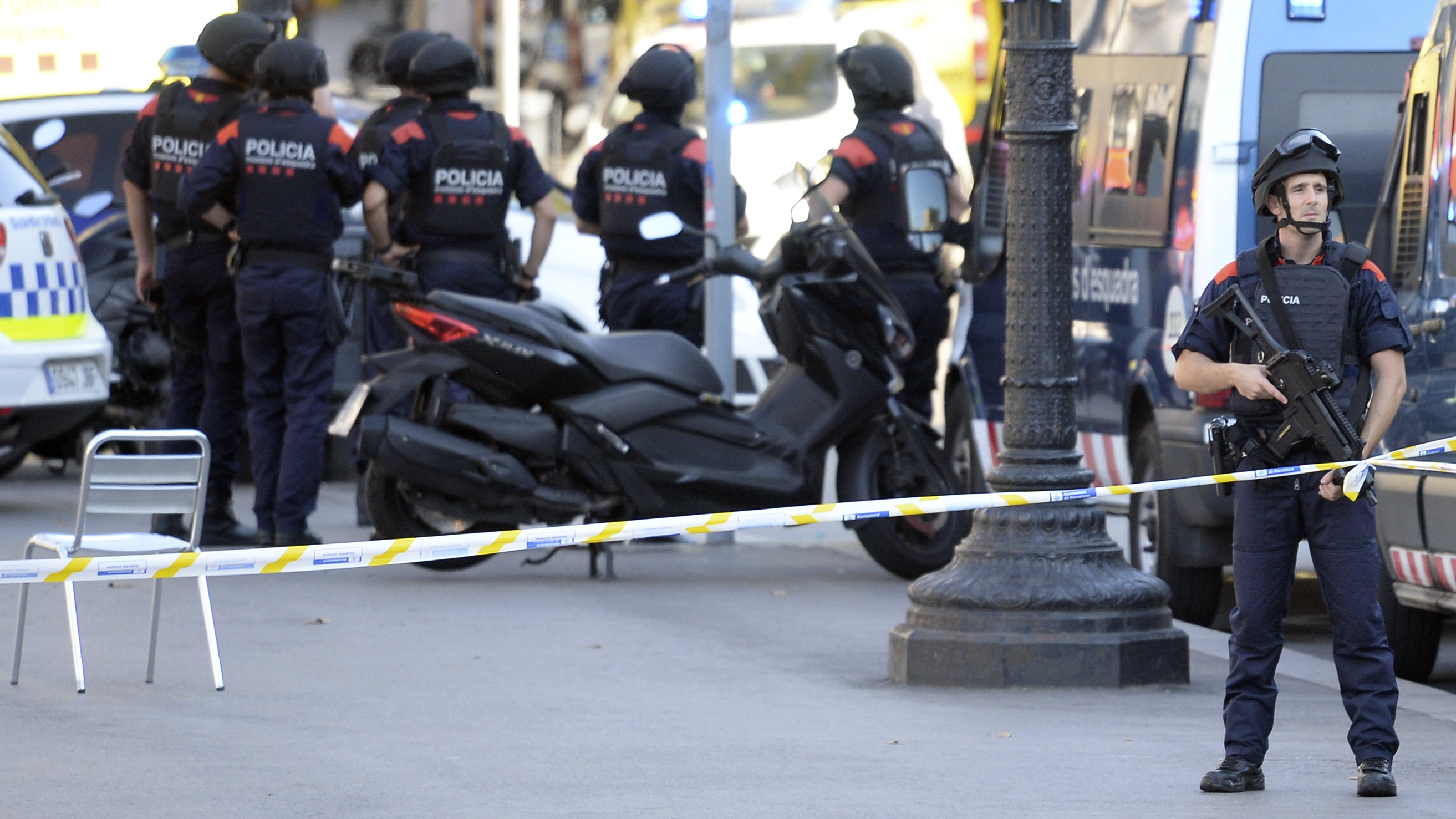 Armed policemen stand in a cordoned-off area on the Rambla in Barcelona, after a van drove into a crowd of pedestrians. Police say the deadly incident was a terror attack. (Josep Lago/AFP/Getty Images)