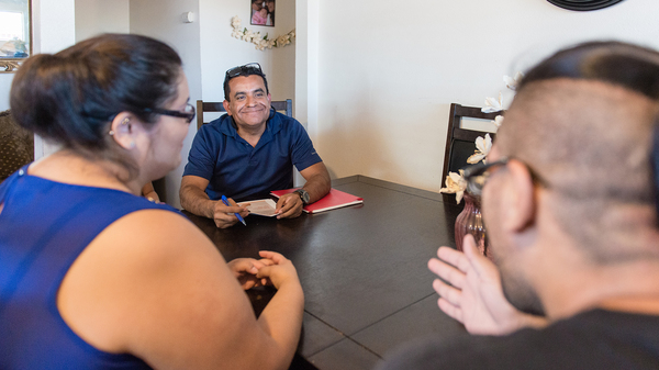 Rosendo Gil, a family support worker with the Imperial County, Calif., home visiting program, has visited Blas Lopez and his fiancée Lluvia Padilla dozens of times since their daughter was born three years ago.
