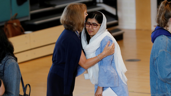 Malala Yousafzai is congratulated after collecting her