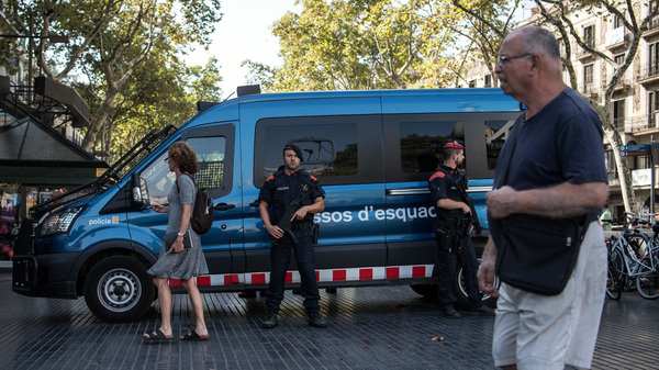 Armed police patrol Las Ramblas following Thursday