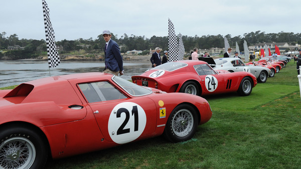 Ferrari race cars are lined up at dawn on Pebble Beach Golf Links