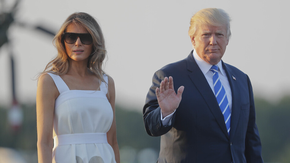 President Trump and first lady Melania Trump walk across the tarmac before boarding Air Force One at Morristown Municipal Airport Sunday to return to Washington. (Pablo Martinez Monsivais/AP)