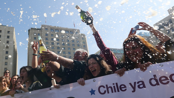 Activists celebrate outside the Constitutional Court in Santiago on Monday. The court approved a measure to ease the country