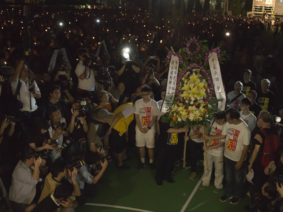 "Cambridge University Press had removed some 300 articles from the ""China Quarterly"" site at the behest of the censors, including articles about the Tiananmen Square military crackdown. Earlier this summer, thousands gathered in Hong Kong to mark the anniversary of the massacre. (Kin Cheung/AP)"