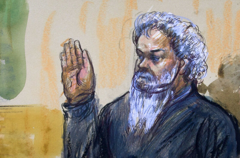 Ahmed Abu Khatallah is sworn in during a hearing at the federal U.S. District Court in Washington, D.C., in June 2014. He has pleaded not guilty to murder and terrorism charges related to the 2012 attack on the U.S. consulate in Benghazi, Libya. (Dana Verkouteren/AP)