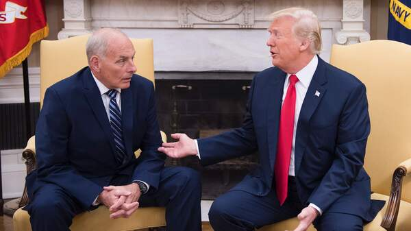 President Trump speaks with newly sworn-in White House chief of staff John Kelly at the White House on July 31. Kelly is one of four former generals who were appointed to top administration positions.