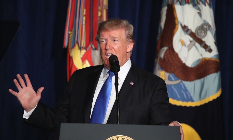 President Trump delivers remarks on America's military involvement in Afghanistan at the Fort Myer military base in Arlington, Va., on Monday. (Mark Wilson/Getty Images)