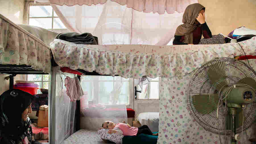 PHOTOS: The Hidden World Of Afghanistan's Nameless Women