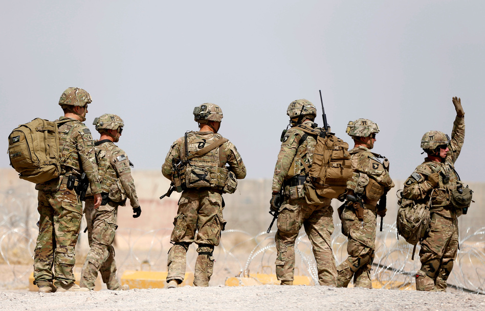 U.S. troops walk outside their base in Uruzgan province, Afghanistan, on July 7. President Trump has presented a new approach to the conflict there. (Omar Sobhani/Reuters)