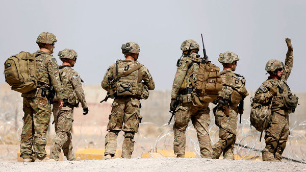 U.S. troops walk outside their base in Uruzgan province, Afghanistan, on July 7. President Trump on Monday presented a new approach to the conflict there.