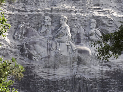 On Stone Mountain near Atlanta, a carving depicts Confederate Civil war figures Stonewall Jackson, Robert E. Lee and Jefferson Davis. (John Bazemore/AP)