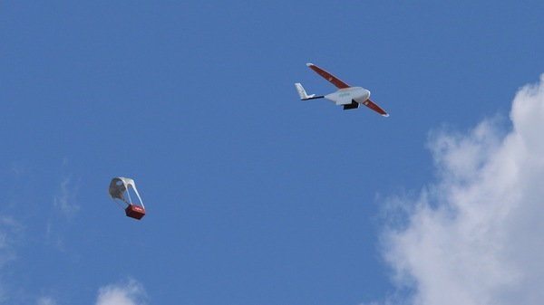 Drones fly through the sky on a delivery in Rwanda.