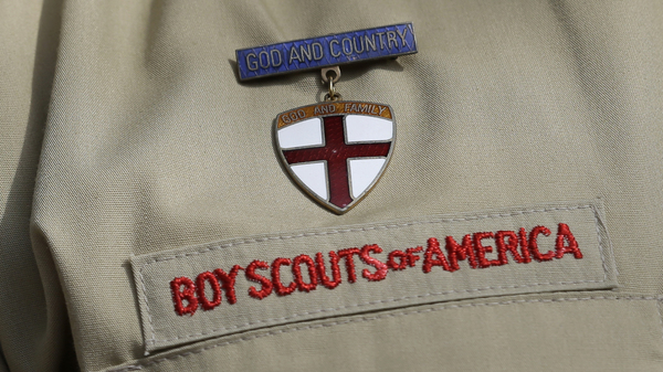 A close up detail of a Boy Scout uniform. The organization has been exploring expanding its programming to girls.