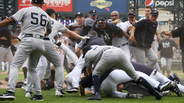 The Yankees and Tigers raise dust on the diamond after both benches cleared in Detroit on Thursday.