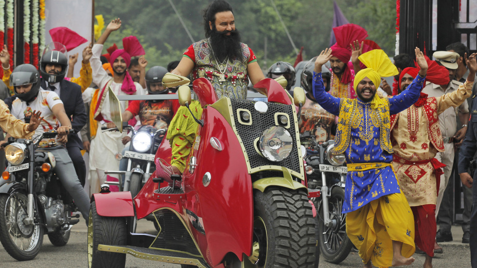 Indian spiritual guru Gurmeet Ram Rahim Singh has been found guilty of raping two female followers. He's seen here last year, arriving for a news conference for his film <em>MSG, The Warrior Lion Heart</em>, in New Delhi. (Tsering Topgyal/AP)
