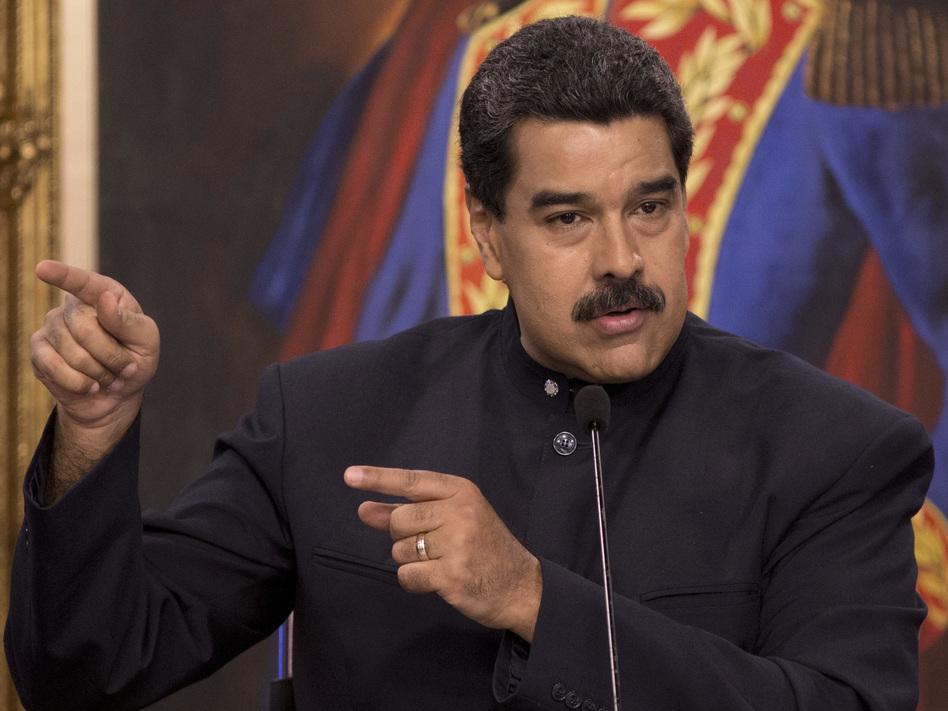 Venezuelan President Nicolas Maduro speaks at a news conference in Caracas, Venezuela, on Tuesday. (Ariana Cubillos/AP)
