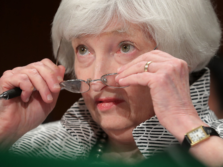 Federal Reserve Chair Janet Yellen testifies before the Senate Banking Committee in July. President Trump has given mixed signals about whether he will re-appoint her when her term as chair expires in February. (Chip Somodevilla/Getty Images)