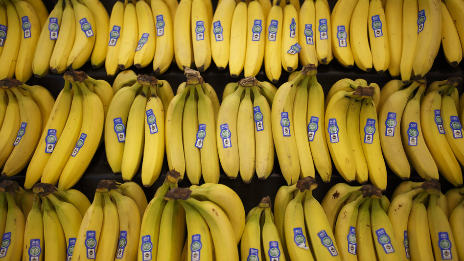 Bananas will be cheaper at Whole Foods stores next week, as Amazon finalizes its purchase of the grocery chain. (Patrick T. Fallon/Bloomberg via Getty Images)