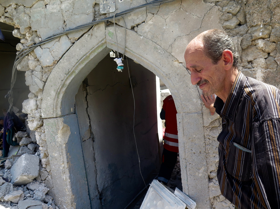 Bashar Abdul Jabar lost his 15-year-old son, Ahmed, when part of their house collapsed during fighting between Iraqi troops and ISIS. He returned to the city to retrieve his boy's body with the help of civil defense forces. (Jane Arraf/NPR)