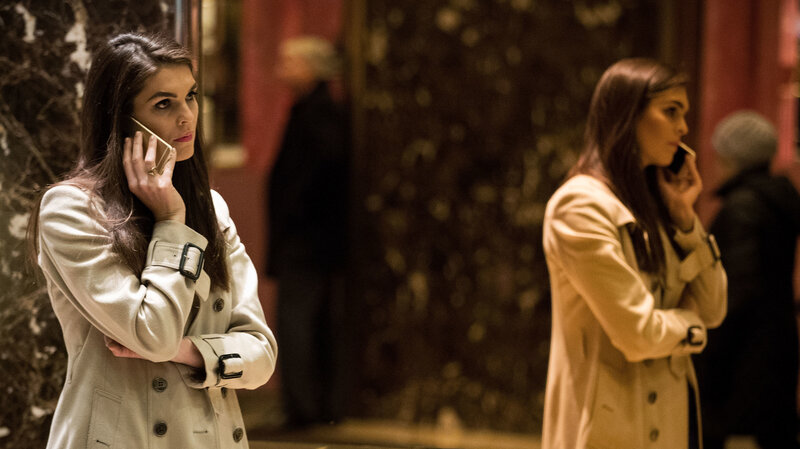 Hope Hicks talks on her phone in the lobby at Trump Tower on December 2016. Her professional style stands in stark contrast to the man who immediately preceded her as communications director, Anthony Scaramucci. (Drew Angerer/Getty Images)
