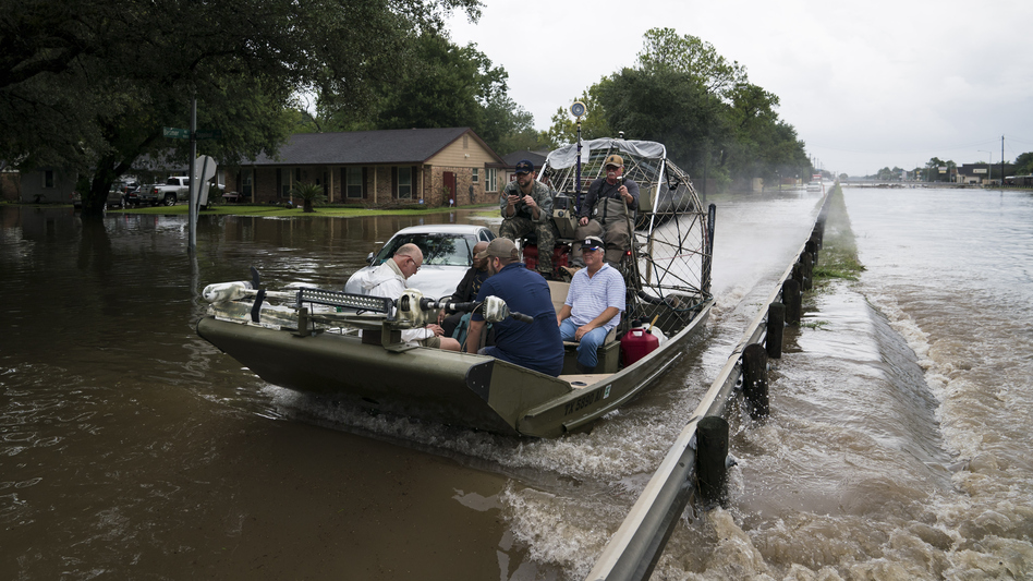Residents and emergency workers in Houston are struggling to cope with intense flooding and rains brought by Hurricane Harvey. Volunteers use an airboat to rescue people from their flooded homes along Beamer Road in Houston on Sunday. (Jabin Botsford/The Washington Post/Getty Images)
