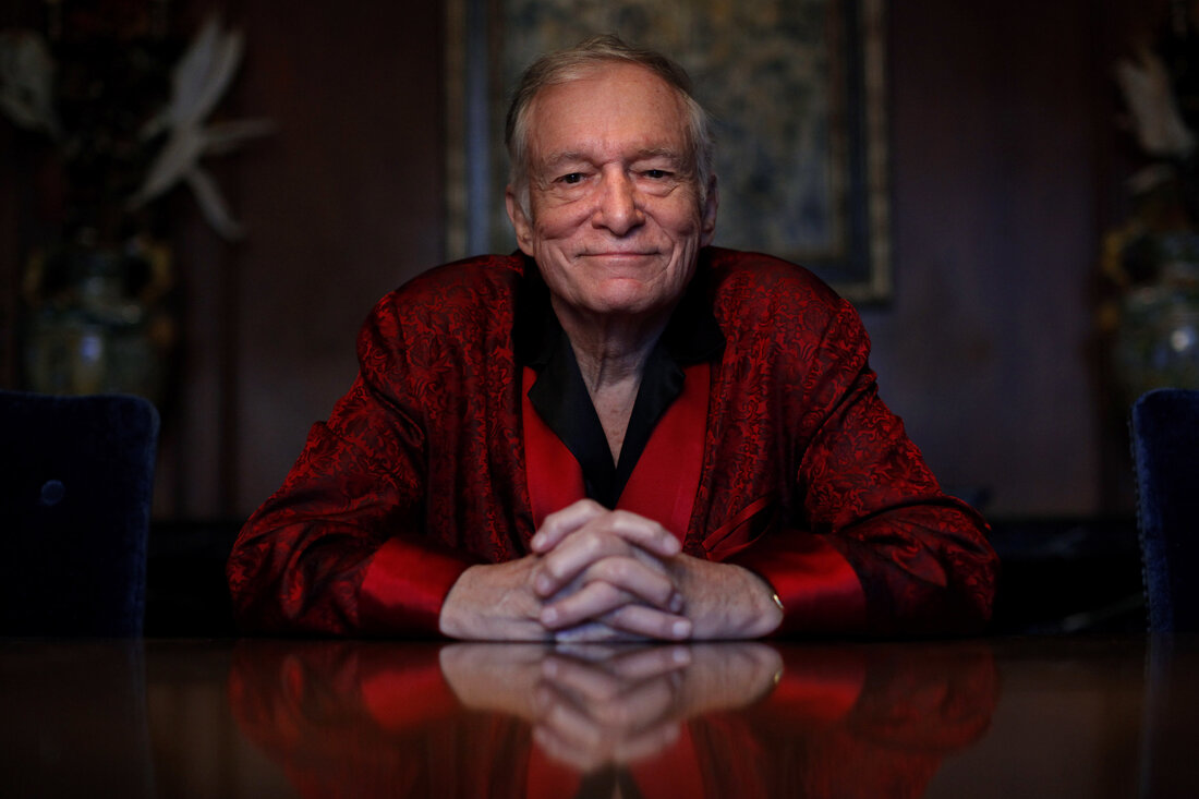 Hefner created Playboy after working as a cartoonist for Esquire. He's pictured here at the Playboy Mansion in 2010.