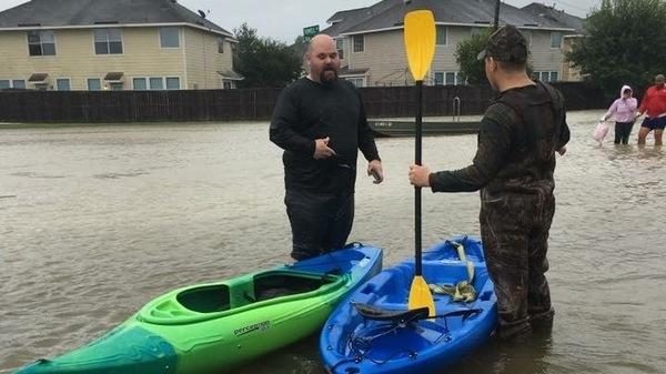 Brandon McElveen (left) is a school counselor at the KIPP Explore Academy elementary school in Houston.