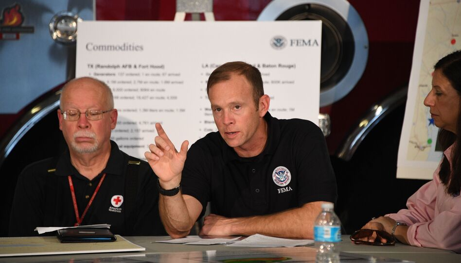 Administrator Brock Long of FEMA (center) speaks during a firehouse briefing on Hurricane Harvey in Corpus Christi, Texas, on Tuesday. (Jim Watson/AFP/Getty Images)