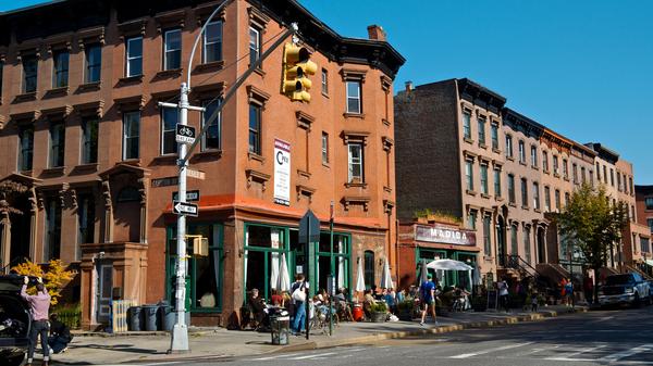 People eat at various restaurants in the Fort Greene neighborhood of Brooklyn, New York.