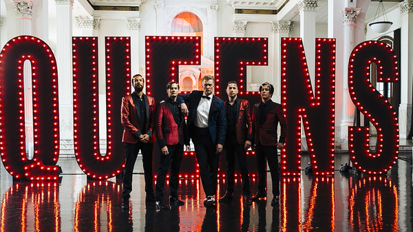 Queens of the Stone Age, led by Josh Homme (center). The band