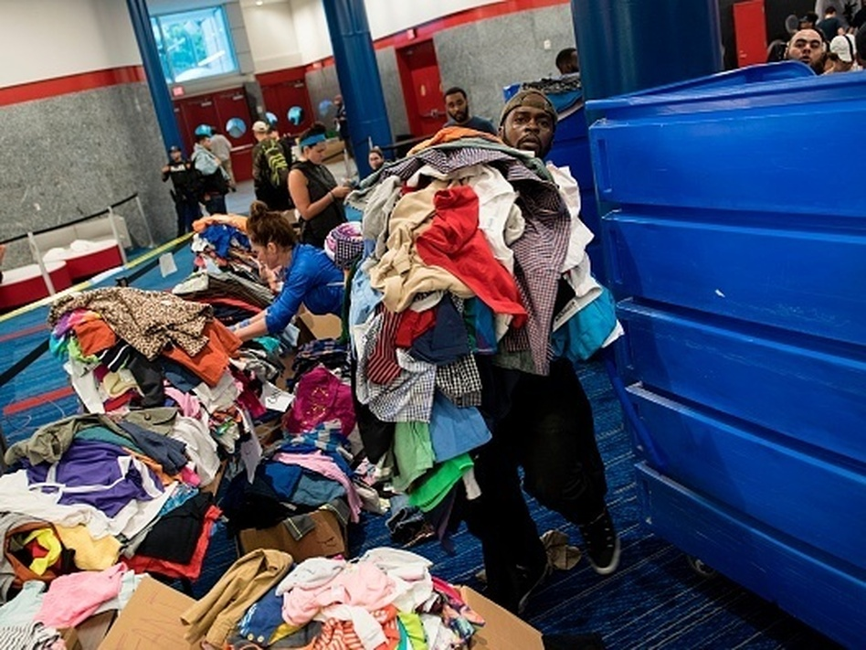 Volunteers sort through donated clothing at a shelter in the George R. Brown Convention Center during the aftermath of Hurricane Harvey on August 28 in Houston, Texas. (Brendan Smialowsk/AFP/Getty Images)