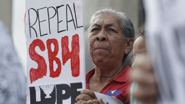 """Protesters gather outside the federal courthouse in San Antonio in June to oppose SB 4, a new Texas law targeting """"sanctuary cities."""""""
