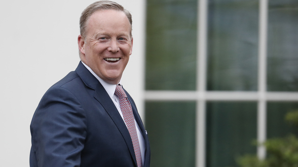 Outgoing White House press secretary Sean Spicer smiles as he departs the White House on July 21. Earlier that day Spicer resigned his position.