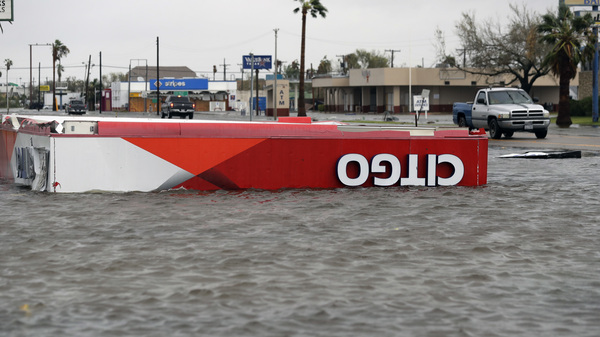 Hurricane Harvey traveled slowly, which allowed the storm to drop enormous quantities of rain. Here the roof of a gas station sits in floodwaters in Aransas Pass, Texas, on Saturday.