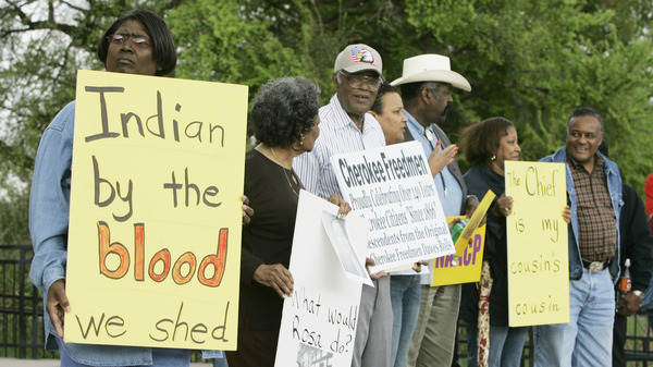 Waynetta Lawrie, left, of Tulsa, Okla., stands with others at the state capitol in Oklahoma City,  in 2007, during a demonstration by several Cherokee Freedmen and their supporters.