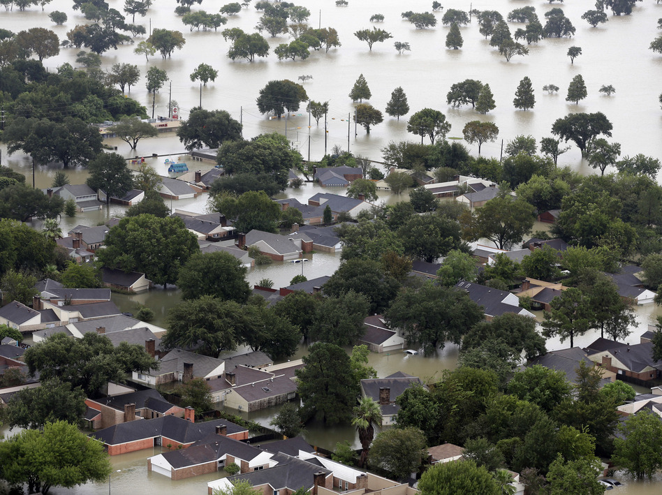 Homes are flooded near the Addicks Reservoir as floodwaters from Tropical Storm Harvey rose on Tuesday in Houston. (David J. Phillip/AP)