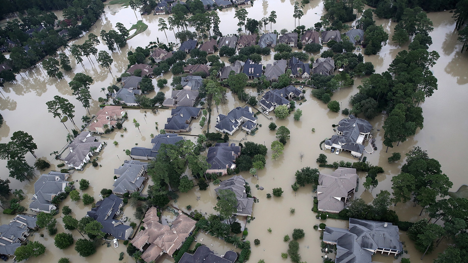 Homes near Lake Houston were almost completely under water on Wednesday. Based on the experiences of past storm victims, returning home could take years. (Win McNamee/Getty Images)