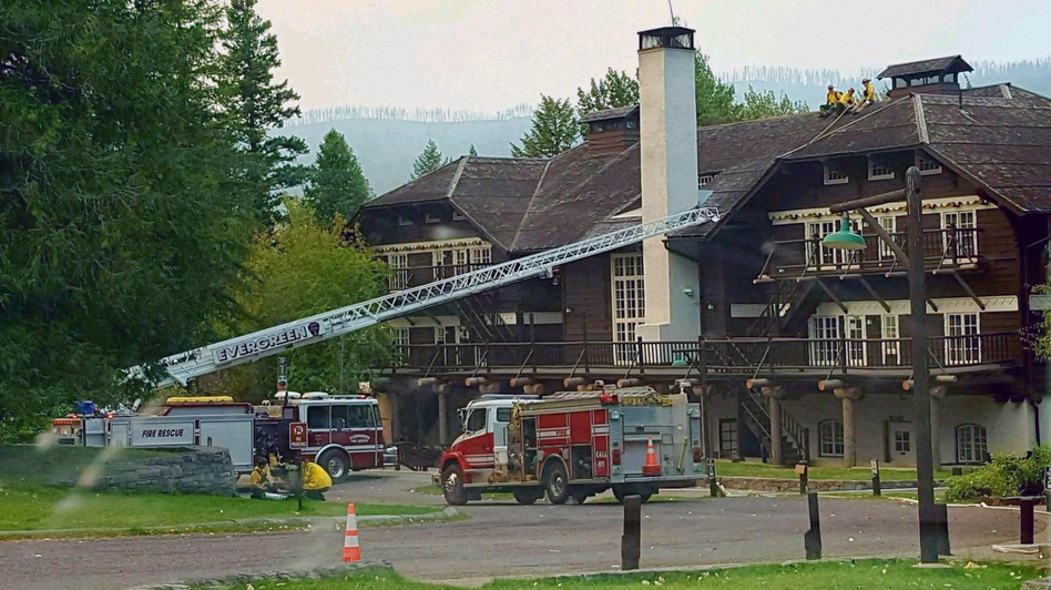 A fire truck is positioned outside Lake McDonald Lodge in Glacier National Park, Mont., on Sunday as firefighters prepare for a blaze that is threatening the century-old Swiss chalet-style hotel. (National Park Service via AP)