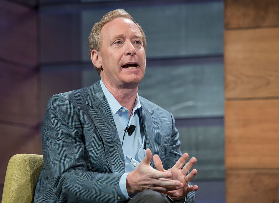 Brad Smith speaks at the Microsoft Annual Shareholders meeting in 2015. The Microsoft president issued sharp words Tuesday against President Trump's decision to cancel DACA in six months and called on Congress to make immigration a top priority. (Stephen Brashear/Getty Images)