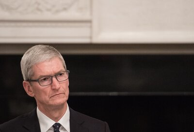 Apple CEO Tim Cook listens to a speaker during an American Technology Council roundtable at the White House on June 19. Cook is speaking out against the decision to end the DACA program, which affects more than 250 Apple employees. (Nicholas Kamm/AFP/Getty Images)