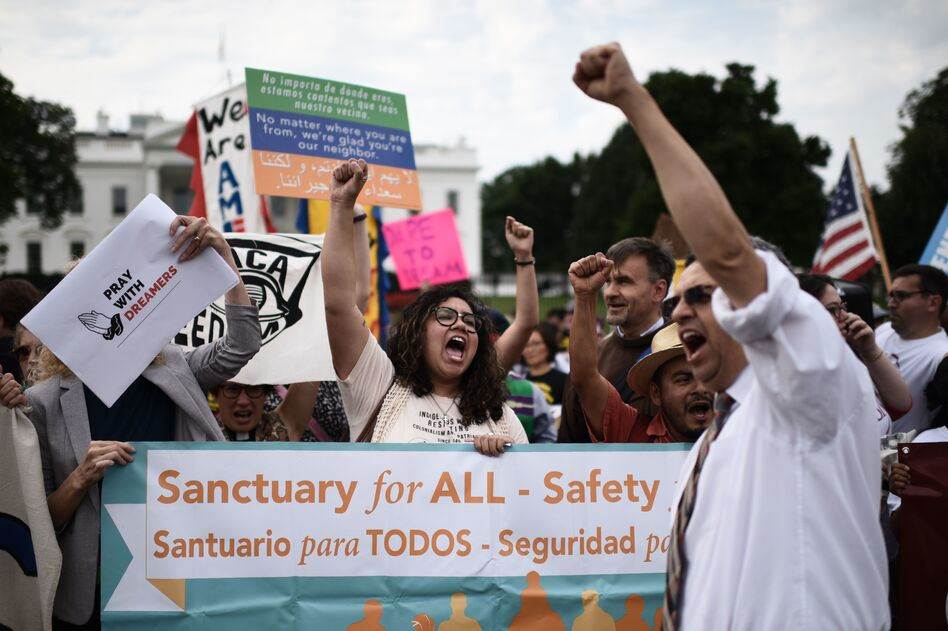 Immigrants and supporters demonstrate during a rally in support of the Deferred Action for Childhood Arrivals program in front of the White House on Tuesday. (Eric Baradat/AFP/Getty Images)