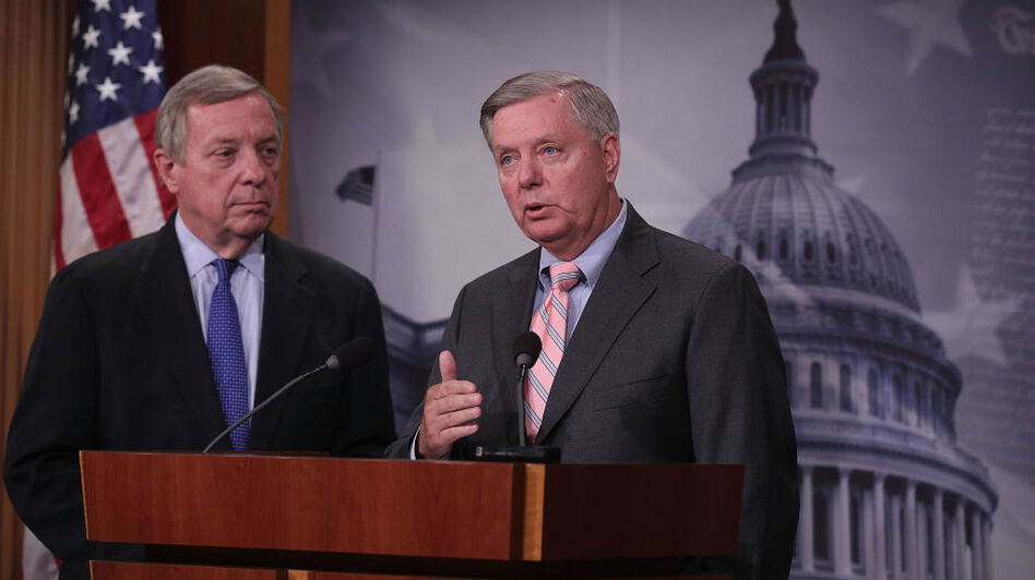 Sens. Lindsey Graham, R-S.C., and Dick Durbin, D-Ill., spoke about their Dream Act to help protect DACA recipients at a press conference on Tuesday. (Alex Wong/Getty Images)