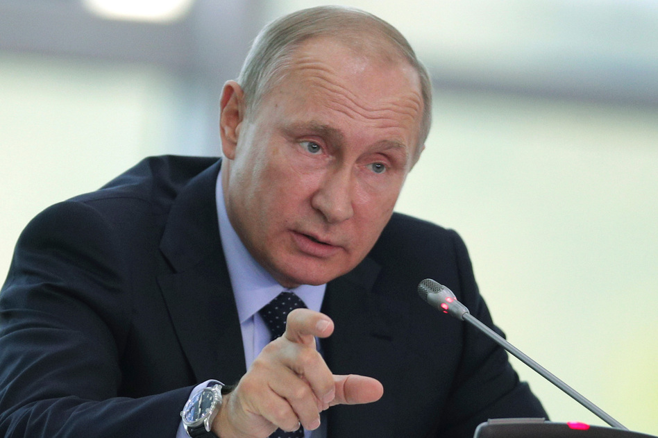 Russian President Vladimir Putin, infuriated with the sanctions of the Magnitsky Act, retaliated by imposing a ban on Russian adoptions. (Sergei Bobylev/TASS News Agency Pool Photo via AP)