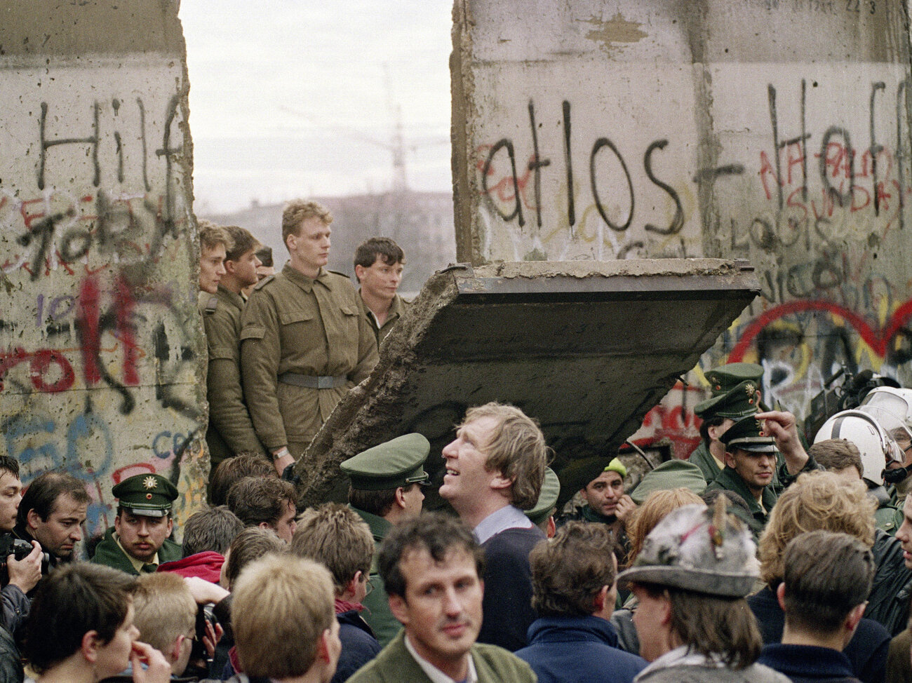 West Berliners crowd in front of the Berlin Wall on Nov. 11, 1989, as they watch East German border guards demolishing a section of the wall in order to open a new crossing point between East and West Berlin. (Gerard Malie /AFP/Getty Images)