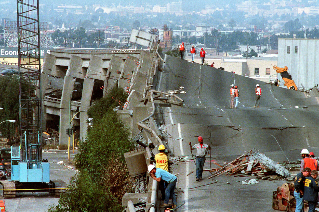 Workers check the damage to Interstate 880 in Oakland. The San Francisco-Oakland Bay Bridge collapsed during the Loma Prieta earthquake on Oct. 17, 1989. (Paul Sakuma/AP)