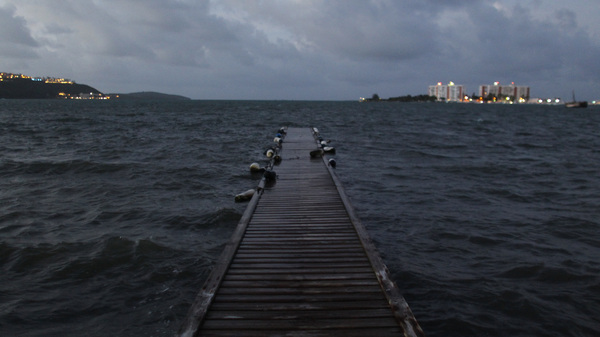 Seawater rises with the approach of Hurricane Irma, which threatened to overwhelm a jetty in Puerto Rico on Tuesday. The U.S. territory of some 3.4 million people has struggled to pay its debts — even filing earlier this year for a procedure similar to bankruptcy, and a natural catastrophe could compound that fiscal pain.