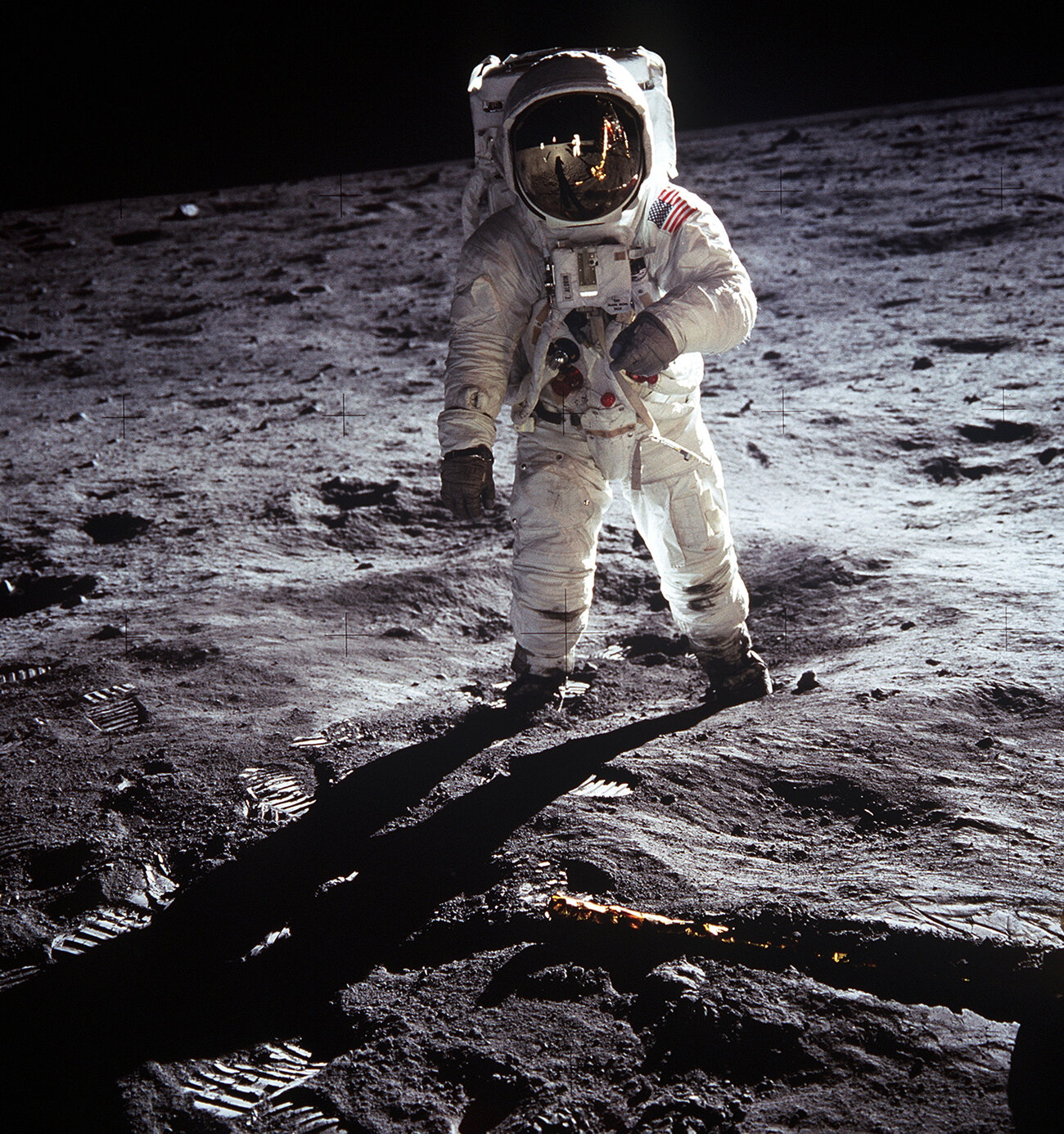 Astronaut Buzz Aldrin walks on the surface of the moon near the leg of the lunar module Eagle during the Apollo 11 mission. (Neil Armstrong/NASA)