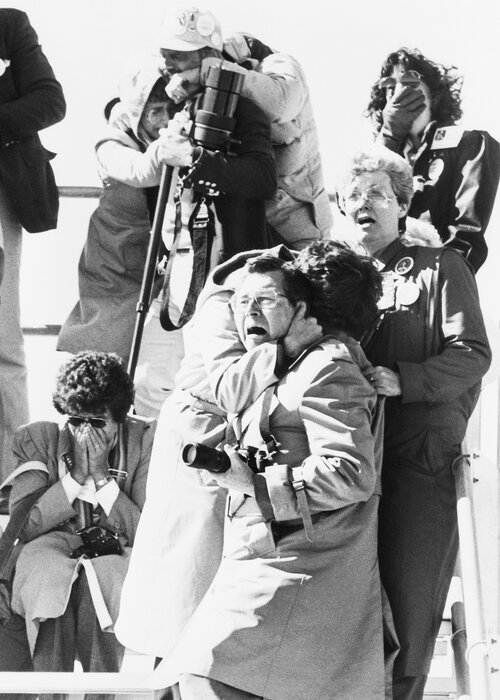 Spectators' faces register horror, shock and sadness after witnessing the explosion of the space shuttle Challenger 73 seconds after liftoff on Jan. 28, 1986. (Bettmann/Bettmann Archive)