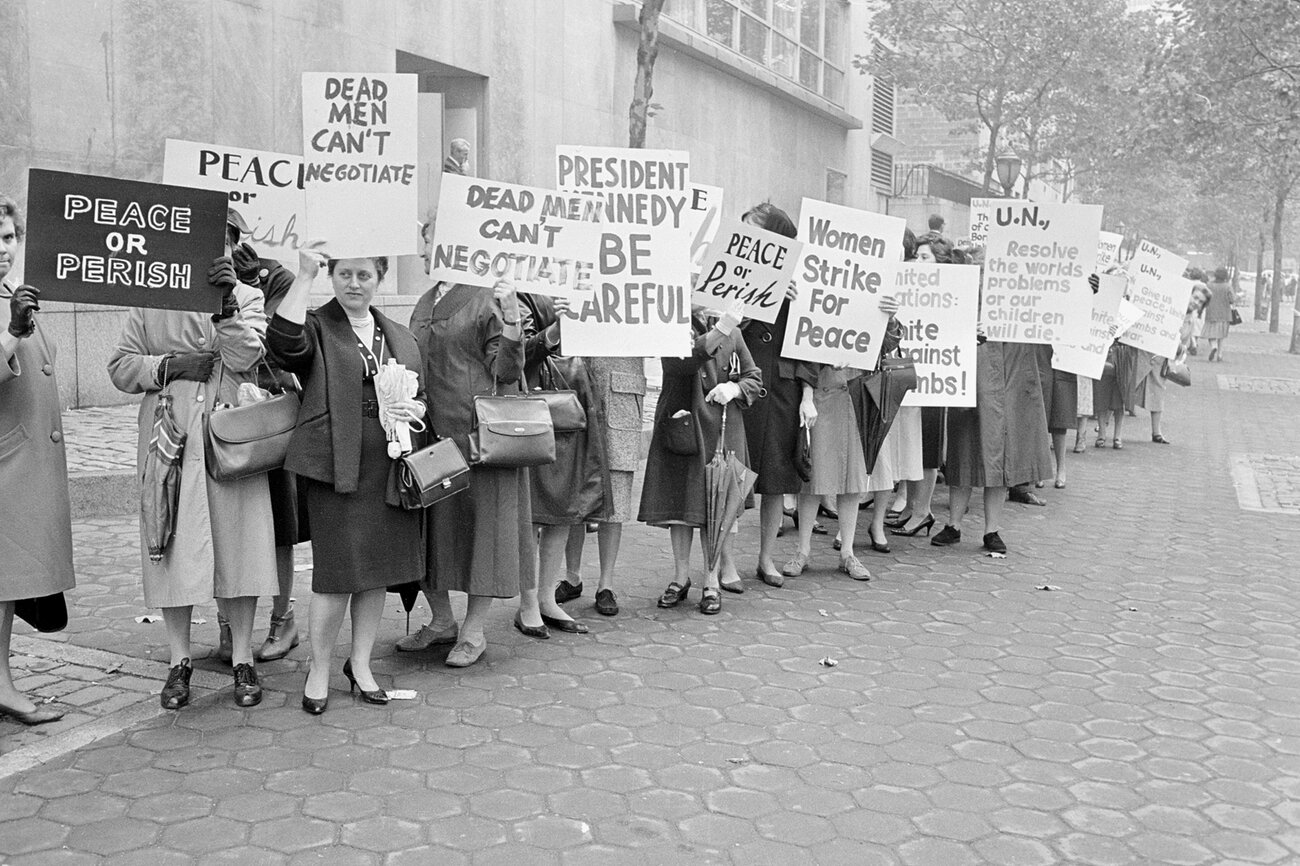 Pickets representing an organization known as Women Strike for Peace carry placards outside the United Nations headquarters in New York City, where the U.N. Security Council considers the Cuban Missile Crisis in a special meeting on Oct. 23, 1962.     AP
