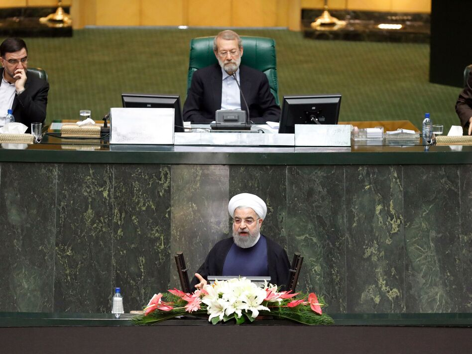 President Hassan Rouhani addresses Iran's Parliament on Aug. 20. He said the top foreign policy priority for his new government would be to protect the nuclear deal. (STR/AFP/Getty Images)